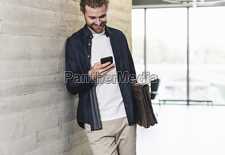 smiling casual businessman standing on office