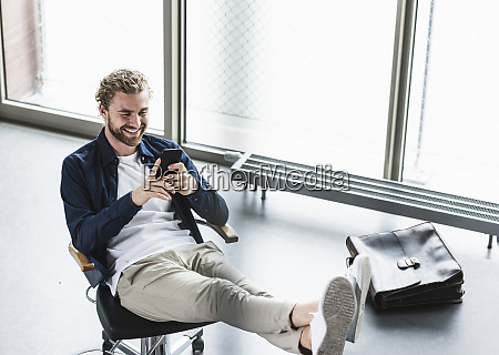 smiling casual businessman sitting in office