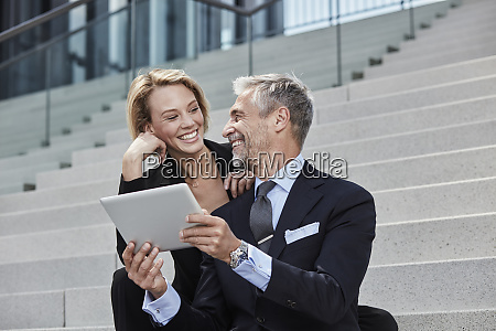 portrait of two laughing business people