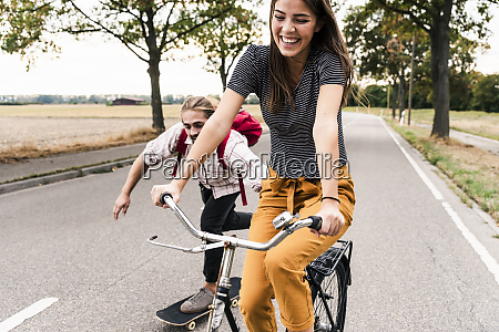 happy young couple with bicycle and