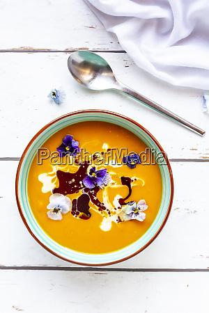 bowl of creamed pumpkin soup garnished