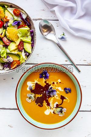 bowl of mixed salad with edible