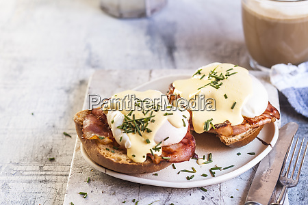 traditional egg benedict with slices of