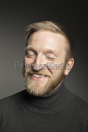 portrait of smiling bearded man with