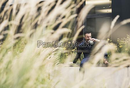 businessman sitting outside taking a break
