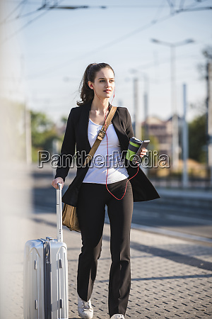 young woman with luggage in the