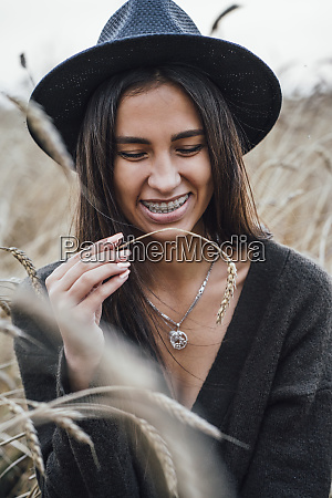 portrait of laughing young woman dressed