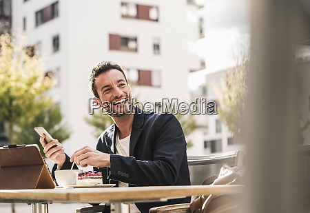 businessman sitting in cafe drinking coffee