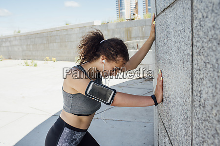 young athletic woman listening to music