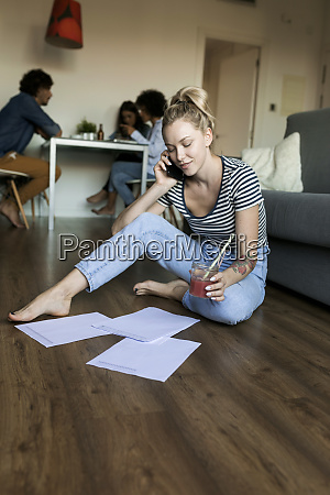 young woman sitting on floor with