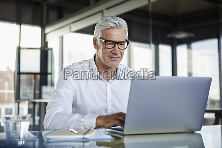 businessman working in office using laptop