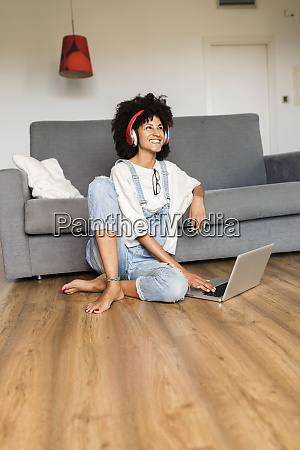 happy woman sitting at home with