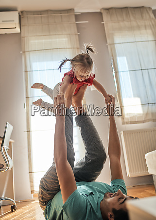 father playing with his little daughter