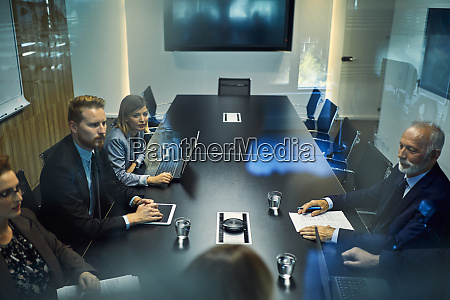 group of business people discussing in