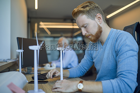 man in office with model wind