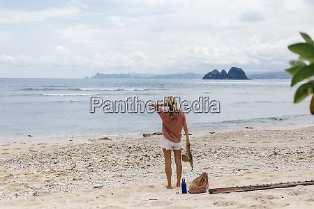rear view shot of single woman