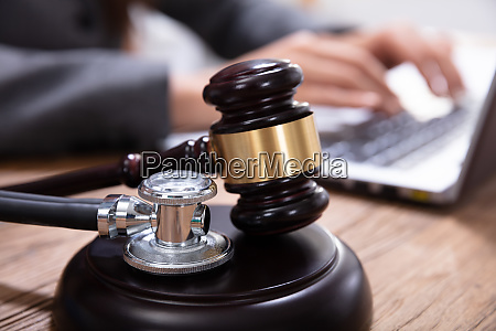 mallet and stethoscope on gavel over