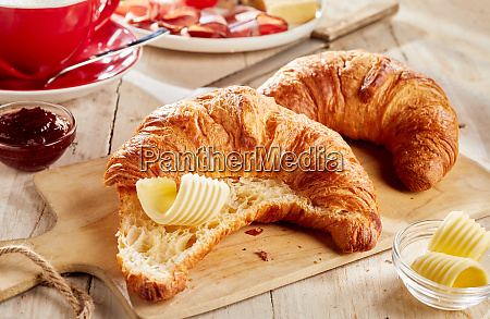 sliced croissant served with butter