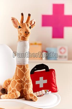toy giraffe with bandaged neck