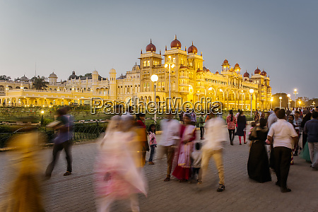 city palace people walking outside the