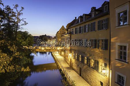 buildings along river regnitz at dusk