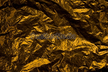 crumpled gold foil background texture with