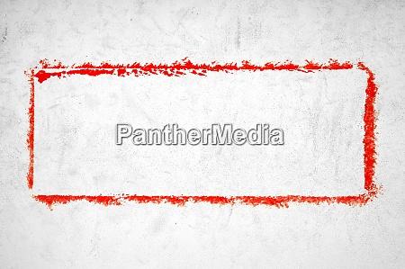 betonwand mit rot gezogenem rahmen
