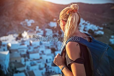 traveler girl enjoying mountainous village view