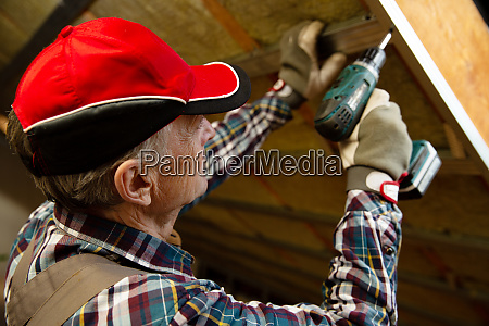 attic insulation and renovation man fixing