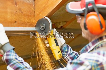 man fixing metal frame using angle