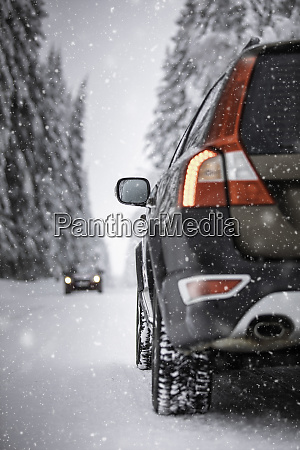 car snowy winter road forests