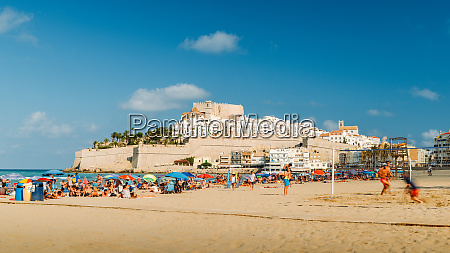 crowded beach and the medieval fort