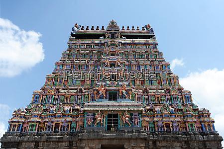 main ornately carved painted gopuram at