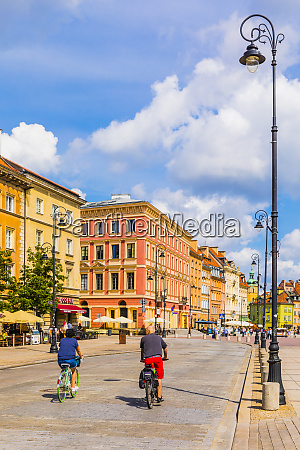 cyclists cycling in warsaw poland europe