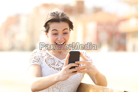 excited girl reading amazing news on