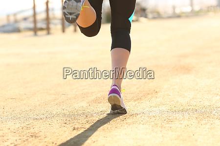 runner legs running outdoors