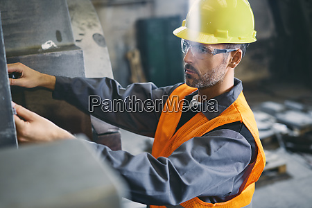 man wearing protective workwear working in