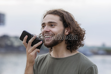 portrait of happy young man using