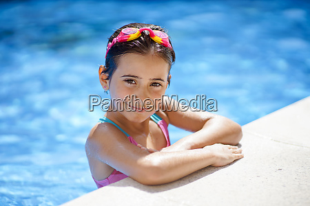 young girl wearing swimmming goggles at