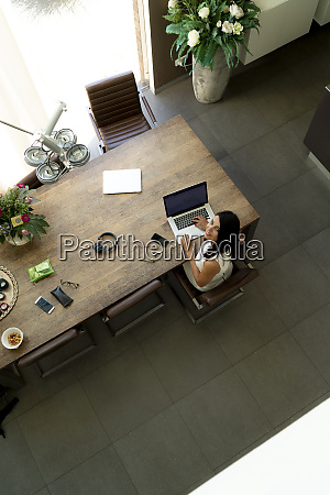 overhead view of woman using laptop