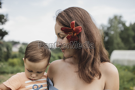 mother with flower in her hair