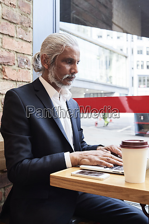 senior businessman sitting in a coffee