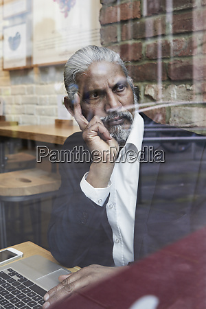 portrait of pensive senior businessman in