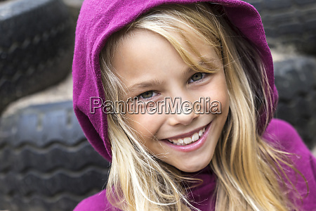 portrait of smiling blond girl wearing