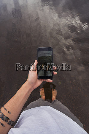 man taking a cell phone picture