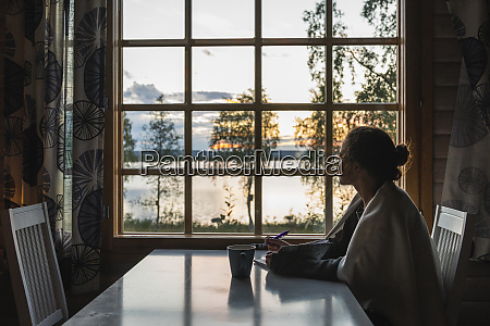 finland lapland young woman sitting at