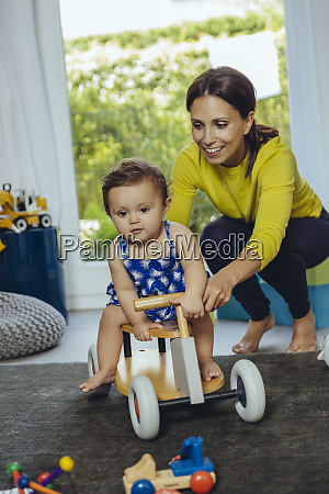 happy mother with baby daughter driving