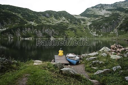 austria tyrol fieberbrunn wildseeloder woman sitting