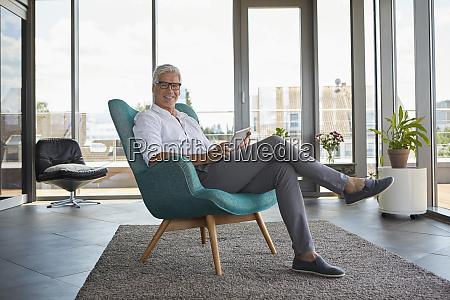 portrait of mature man sitting in