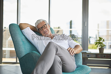portrait of smiling mature man relaxing